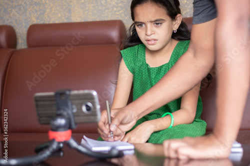 Stampa su Tela Father helping daughter by solving problem while studying the lesson from online class or e-learning - concept of Role of parents in supporting child during homeschooling, distance learning