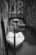 Canal With Moored Boats In Ven...
