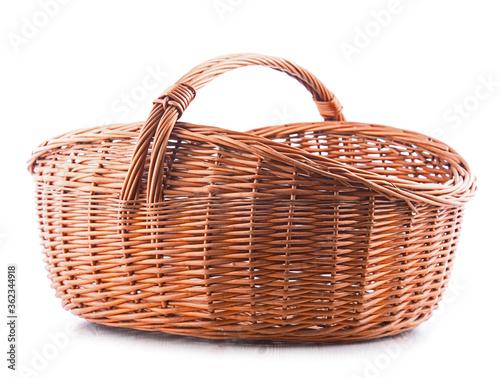 Fototapeta Empty wicker basket isolated on white