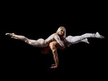 Couple Acrobats Perform A Tric...