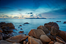 Seychelles Landscape Long Exposure Waterscape Praslin Over Indian Ocean With Large Granite Rocks Turquoise Water Blue Sky Behind White Wispy Clouds Heaven