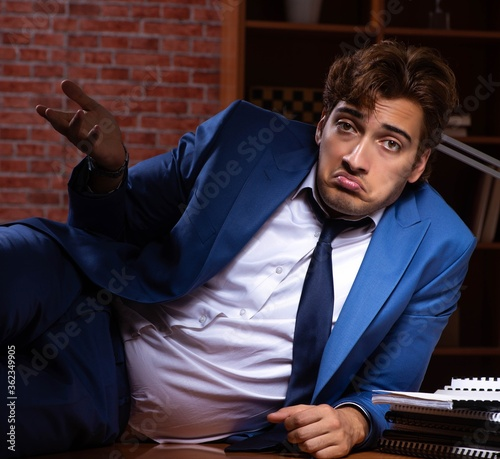 Young businessman working in the office at night