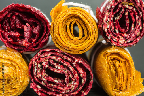 rolls of raspberry and apricot fruit leather Fototapete