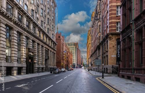 Canvas Print An empty streetscene of Whitworth Street under a vibrant blue sky