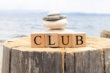The Word Club From Wooden Cubes. The Cubes Are On The Tree Stump.