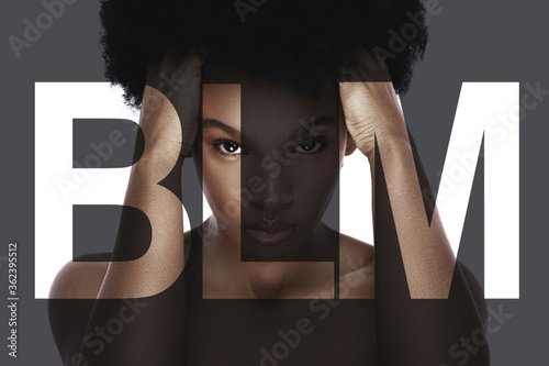 Fototapeta Portrait of young black woman with a lettering BLM obraz