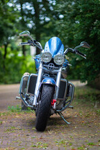 21 July 2019, Scheveningen, The Hague, Netherlands, Europe. Powerful Metallic Blue Triumph Motorcycle Parked On The Street