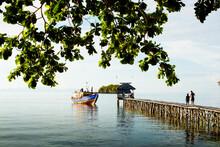Local Boat Approaching Pier Of Togean Island Kadidiri, Sulawesi, Indonesia