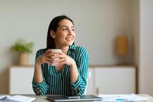 Entrepreneur Woman Smiling Hav...