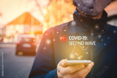 Fototapeta Notification about second wave of covid-19 on smart phone obraz