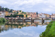 Florence or Firenze, Ponte delle Grazie bridge, landmark on Arno river, landscape with reflections on the water. Tuscany, Italy.
