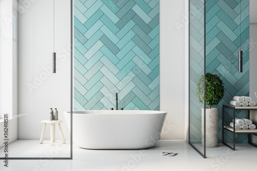 Modern turquoise bathroom interior with bathand self care products.