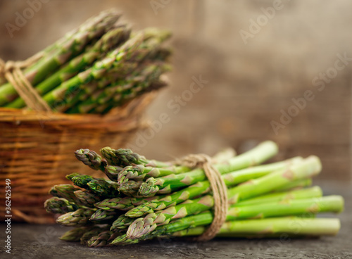 Asparagus. Fresh raw organic green Asparagus sprouts closeup. On wooden table. Healthy vegetarian food. Raw vegetables, market. Healthy eating concept, diet, dieting.  #362425349