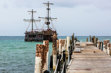 Dramatic Seascape Image Of Aqua Blue Caribbean Water With A Pirate Ship In Harbor In Punta Cana, Dominican Republic.