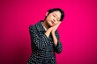 Leinwanddruck Bild - Young beautiful asian girl wearing casual jacket standing over isolated pink background sleeping tired dreaming and posing with hands together while smiling with closed eyes.