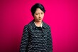 canvas print picture - Young beautiful asian girl wearing casual jacket standing over isolated pink background skeptic and nervous, frowning upset because of problem. Negative person.