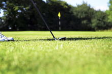 A Golf Club Putting A Golf Ball Into The Hole