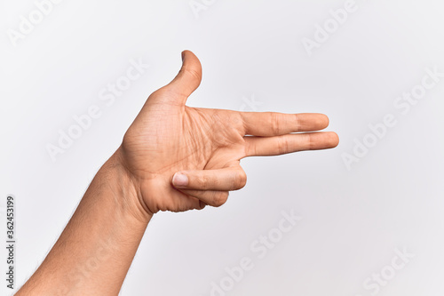 Hand of caucasian young man showing fingers over isolated white background gestu Canvas Print