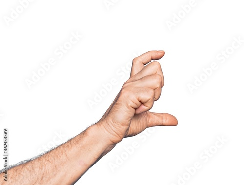 Valokuva Hand of caucasian middle age man over isolated white background picking and taki