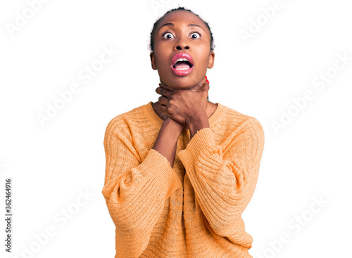 Young african american woman wearing casual clothes shouting and suffocate because painful strangle Canvas Print