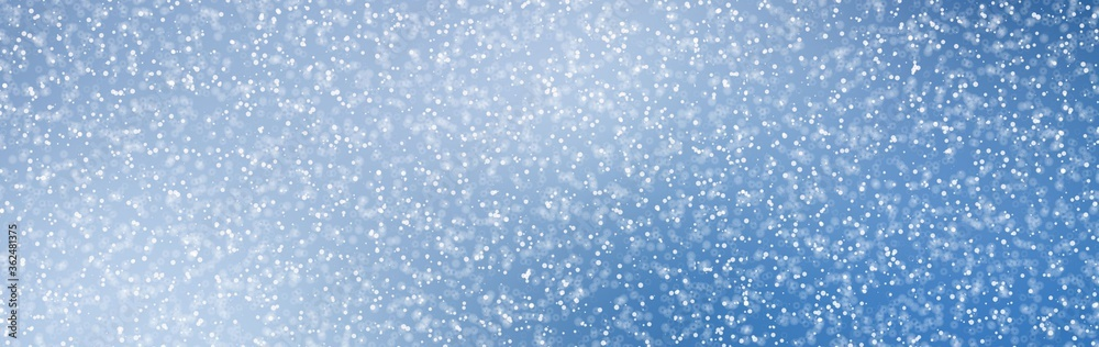 Fototapeta Abstract Blue Christmas Background with Real Snow. Blurred Snowflakes