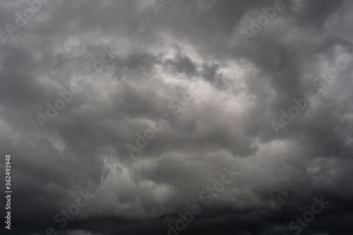 Fototapeta Cloudy stormy black and white dramatic sky background