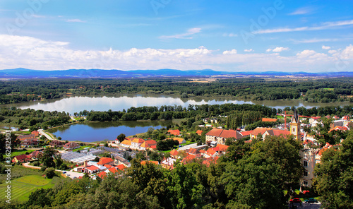 Fototapeta Picturesque aerial view at the famous Czech town Hluboka nad Vltavou from the castle on the blue sky background. obraz na płótnie