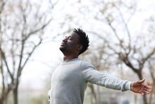 Satisfied Black Man Breathing Fresh Air In The Park