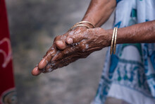 Old Woman Washing His Hands Wi...