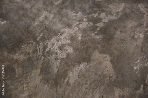 Fototapeta fondo abstracto con manchas grises sobre suelo de cemento