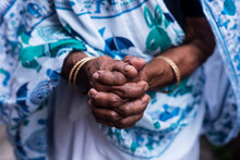 Old Woman Folding Her Hands To Offer Prayers To God With White Printed Saree As A Background. Hands Are Fragile And Old.