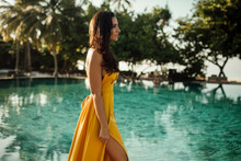 Side View Of Young Woman Walking By Pool