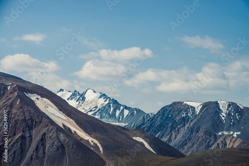 Fotografie, Obraz Atmospheric alpine view to big mountain with snowy high sharp tops