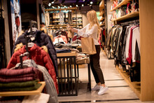 Young Woman Shopping And Searc...