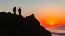 People Silhouetted Beach Rock ...
