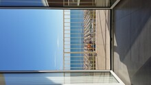 View Of Sea Against Clear Blue Sky Seen Through Window
