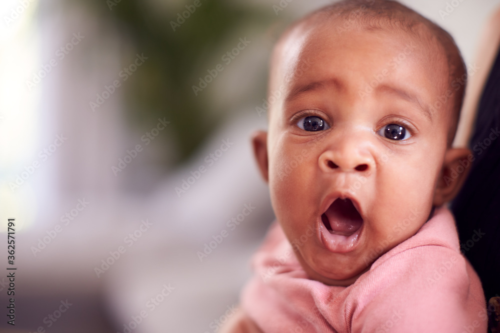 Fototapeta Portrait Of Smiling Baby Girl With Open Mouth In Sling