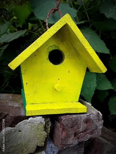 Close-up Of Yellow Birdhouse Fotobehang