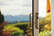 Close-up Of Door Handles Against Sky