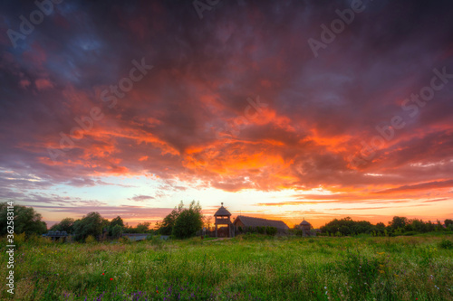 Fotomural Beautiful sunset over the settlement of Trade Factory in Pruszcz Gdanski, Poland