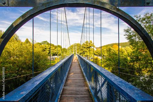 Fotografiet Footbridge In City Against Sky