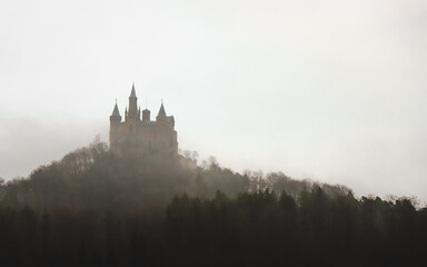 Castle On Top Of Mountain In Foggy Weather