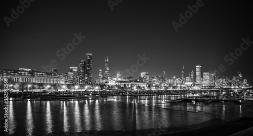 Fototapety, obrazy: Illuminated City By Sea Against Clear Sky At Night