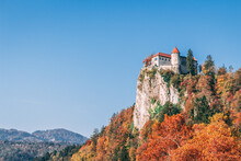 Low Angle View Of Castle On Cliff Against Clear Blue Sky