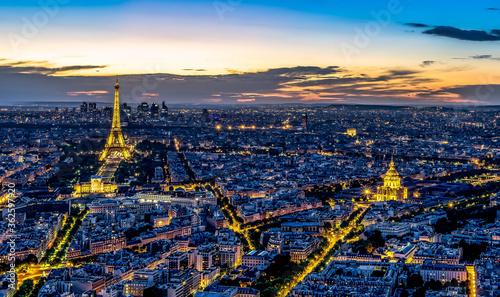 Fotografie, Obraz Eiffel Tower Amidst Cityscape At Dusk