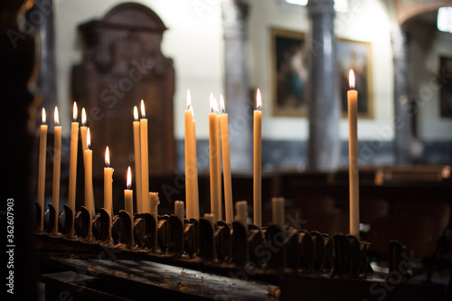 Photo Burning Candles In A Church
