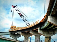 Low Angle View Of Bridge Construction Against Sky