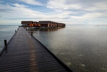 Pier Over Sea Against Sky Duri...