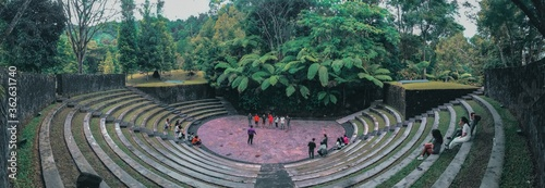 Stampa su Tela High Angle View Of People In Amphitheater Against Trees
