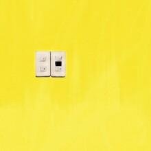 Close-up Of Light Switch On Ye...